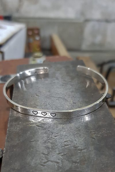 engraved cuff with 3 hearts